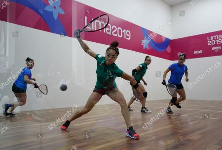 Mexico's Paola Longoria returns a ball as she and her partner Samantha Salas play to win against Guatemala's Gabriela Martinez, left, and Maria Rodriguez in the women's racquetball team gold medal match at the Pan American Games in Lima, Peru