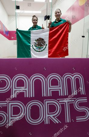 Mexico's Paola Longoria, left, and Samantha Salas pose for pictures with a Mexican flag as they celebrate defeating Guatemala's Gabriela Martinez and Maria Rodriguez in the women's racquetball team gold medal match at the Pan American Games in Lima, Peru