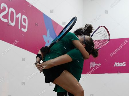 Mexico's Samantha Salas lifts up her teammate Paola Longoria in an embrace after they defeated Guatemala's Gabriela Martinez and Maria Rodriguez in the women's racquetball team gold medal match at the Pan American Games in Lima, Peru