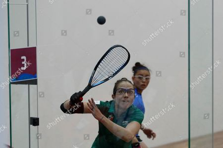Mexico's Samantha Salas, playing with partner Paola Longoria, returns a ball off the glass back wall as Guatemala's Gabriela Martinez, playing with Maria Rodriguez, looks, in the women's racquetball team gold medal match at the Pan American Games in Lima, Peru, . Mexico defeated Guatemala to take gold