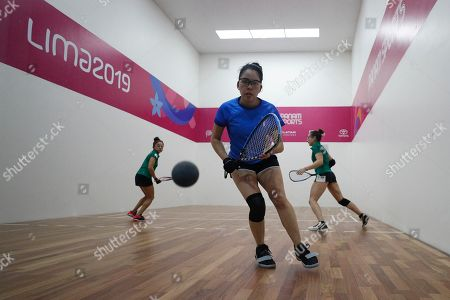 Guatemala's Maria Rodriguez, playing with partner Gabriela Martinez, prepares to hit a ball bouncing off the glass back wall of the court, in their match against Mexico's Samantha Salas, right, and Paola Longoria, in the women's racquetball team gold medal match at the Pan American Games in Lima, Peru, . Mexico defeated Guatemala to take gold