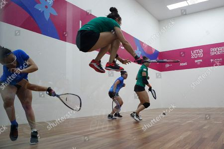Mexico's Paola Longoria, playing with partner Samantha Salas, jumps to avoid a ball hit by Guatemala's Gabriela Martinez, left, playing with partner, Maria Rodriguez, in the women's racquetball team gold medal match at the Pan American Games in Lima, Peru