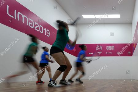 Mexico's Paola Longoria and Samantha Salas play Guatemala's Gabriela Martinez and Maria Rodriguez in the women's racquetball team gold medal match at the Pan American Games in Lima, Peru