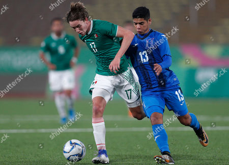 Marcel Ruiz, Carlos Pineda. Marcel Ruiz of Mexico, left, controls the ball under pressure by Carlos Pineda of Honduras, during the men's semifinal soccer match at the Pan American Games in Lima Peru
