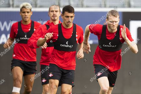 Spartak's Andre Schuerrle (R) and his teammates warm up during their training session in Thun, Switzerland, 07 August 2019. Spartak Moscow will face FC Thun in their UEFA Europa League qualifying third round, first leg soccer match on 08 August 2019.