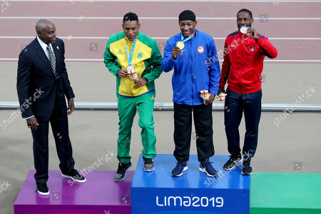 Stock Image of Nine-time Olympic gold medalist Carl Lewis looks at Michael Rodgers of United States, center, silver medalist Paulo Camilo De Oliveira of Brazil, left, and bronze medalist Cejhae Greene of Antigua and Barbuda on the podium for the men's 100m during the athletics at the Pan American Games in Lima, Peru