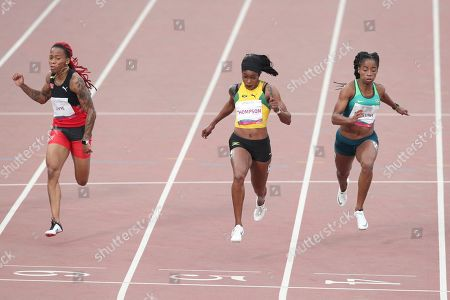 Elaine Thompson of Jamaica, center, wins the 100m final during the athletics at the Pan American Games in Lima, Peru, . Michelle-Lee Ahye of Trinidad and Tobago won silver and Vitoria Cristina Silva of Brazil the bronze