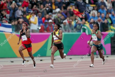 Elaine Thompson of Jamaica runs to win the 100m final during the athletics at the Pan American Games in Lima, Peru, . Michelle-Lee Ahye of Trinidad and Tobago won silver and Vitoria Cristina Silva of Brazil bronze