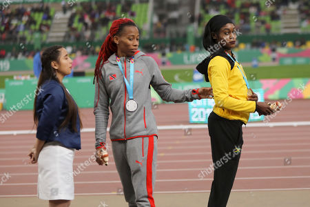 Gold medalist Elaine Thompson of Jamaica, right, and silver medalist Michelle-Lee Ahye of Trinidad and Tobago stand on the podium for the women's 100m during the athletics at the Pan American Games in Lima, Peru