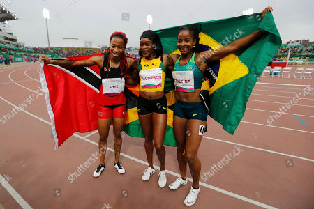 The gold medalist Elaine Thompson of Jamaica, center, silver Michelle-Lee Ahye of Trinidad and Tobago, left, and bronze Vitoria Cristina Silva of Brazil pose for photos after the women's 100m final during the athletics at the Pan American Games in Lima, Peru