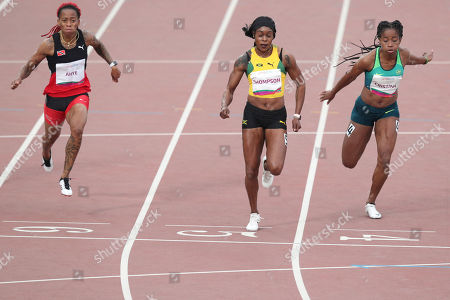 Elaine Thompson of Jamaica, center, wins the 100m final during the athletics at the Pan American Games in Lima, Peru, . Michelle-Lee Ahye of Trinidad and Tobago, left, won silver and Vitoria Cristina Silva of Brazil bronze