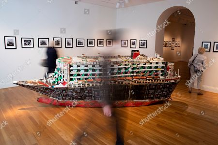 Stock Photo of Visitors walk around the 2007 metal sculpture entitled 'Queen Mary II, La mere (The Mother)' by artist Adel Abdessemed, who was born in Algeria and lives in France; on display during the ongoing art exhibit, 'The Warmth of Other Suns - Stories of Global Displacement', at the Phillips Collection in Washington, DC, USA, 07 August 2019. The exhibit, which runs through 22 September 2019, shows creations of seventy-five artists whose work pertains to the experiences and perceptions of migration and the global refugee crisis.