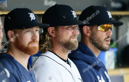 Detroit Tigers pitcher Trevor Rosenthal, center, sits with fellow pitchers Spencer Turnbull, left, and Drew VerHagen, right, after pitching during the eighth inning of a baseball game against the Chicago White Sox, in Detroit. Rosenthal was designated for assignment follow the Tigers 8-1 loss to the White Sox
