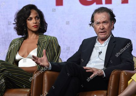 "Megalyn Echikunwoke, Timothy Hutton. Megalyn Echikunwoke, left, and Timothy Hutton participate in Fox's ""Almost Family"" panel at the Television Critics Association Summer Press Tour, in Beverly Hills, Calif"