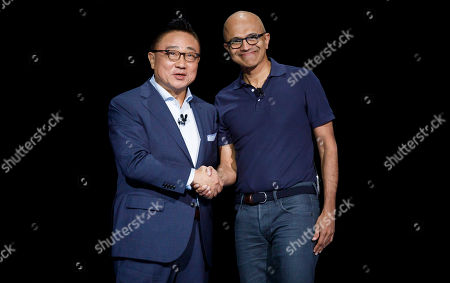 Dong Jin Koh (L), the president and CEO of Samsung, and Satya Nadella, the CEO of Microsoft, shake hands during the Samsung Unpacked event at the Barclays Center in Brooklyn, New York, USA, 07 August 2019.