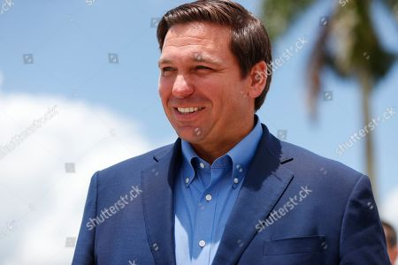 Florida Gov. Ron DeSantis smiles as he arrives at a news conference, at Everglades Holiday Park in Fort Lauderdale, Fla. DeSantis said the state is expanding its efforts to eradicate invasive pythons in the Everglades and is working with the federal government to get snake hunters to remote areas of Big Cypress National Preserve