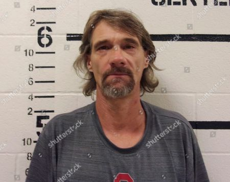 In this photo provided by the Pittsburg County, Oklahoma Sheriff's Office, Jimmy Nace is pictured in a booking photo. Pittsburg County Sheriff Chris Morris said that 46-year-old Jimmy Nace was arrested in connection with the death of 49-year-old Bob Dalpoas along with two other men