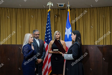 Justice Secretary Wanda Vazquez is sworn in as governor of Puerto Rico by Supreme Court Justice Maite Oronoz, in San Juan, Puerto Rico, . Vazquez took the oath of office early Wednesday evening at the Puerto Rican Supreme Court, which earlier in the day ruled that Pedro Pierluisi's swearing in last week was unconstitutional. Vazquez was joined by her daughter Beatriz Diaz Vazquez and her husband Judge Jorge Diaz