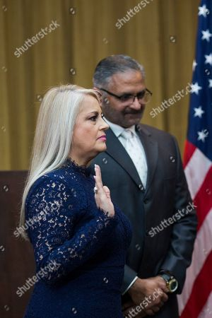 Stock Photo of Justice Secretary Wanda Vazquez is sworn in as governor, accompanied by her husband Judge Jorge Diaz, in San Juan, Puerto Rico, . Vazquez took the oath of office early Wednesday evening at the Puerto Rican Supreme Court, which earlier in the day ruled that Pedro Pierluisi's swearing in last week was unconstitutional