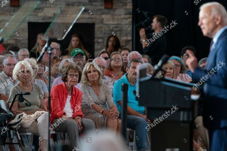 Jill Biden, 3rd from left, listens