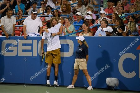Kevin Anderson, Alexander Zverev. Nick Kyrgios, of Australia, hugs a fan in the stands after he beat Norbert Gombos, of Slovakia, in a match in the Citi Open tennis tournament, in Washington. Kyrgios won 6-3, 6-3