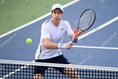 Kevin Anderson, Alexander Zverev. Andy Murray competes as he and Jamie Murray, both of Britain, played a doubles match against Raven Klaasen, of South Africa, and Michael Venus, of New Zealand, in the Citi Open tennis tournament, in Washington