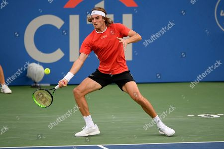 Kevin Anderson, Alexander Zverev. Stefanos Tsitsipas, of Greece, returns the ball during a match against Benoit Paire, of France, in the Citi Open tennis tournament, in Washington
