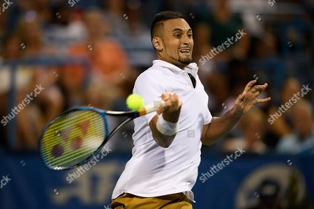 Kevin Anderson, Alexander Zverev. Nick Kyrgios, of Australia, returns the ball during a match against Norbert Gombos, of Slovakia, in the Citi Open tennis tournament, in Washington