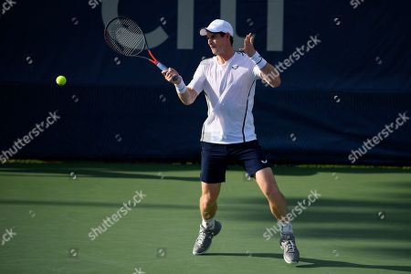 Kevin Anderson, Alexander Zverev. Andy Murray returns the ball as he and Jamie Murray, both of Britain, played a doubles match against Raven Klaasen, of South Africa, and Michael Venus, of New Zealand, in the Citi Open tennis tournament, in Washington