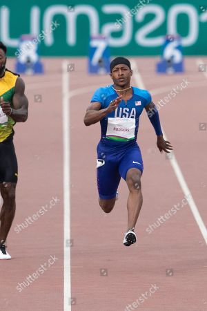 Stock Picture of Michael Rogers of USA runs down the track to win gold in the 100 meters final with a time of 10.09 seconds during the Pan American Games Athletics at Estadio Athletico de la Villa Deportivo Nacional in Lima, Peru