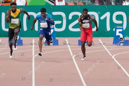 Michael Rogers of USA runs down the track to win gold in the 100 meters final with a time of 10.09 seconds during the Pan American Games Athletics at Estadio Athletico de la Villa Deportivo Nacional in Lima, Peru