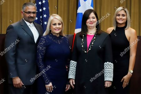 Stock Picture of Wanda Vazquez Garced (2-L), swears in the position of Governor before the Chief Justice of the Supreme Court, Maite Oronoz (2-R), accompanied by her husband, Judge Jorge Diaz Reveron (L) and her daughter Beatriz Diaz (R), in San Juan, Puerto Rico, 07 August 2019. Vazquez became the new Governor of the island, as provided by the legal system, after the Supreme Court annulled the controversial swearing of Pedro Pierluisi.