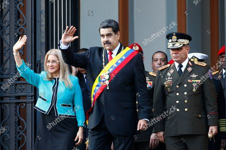 Stock Image of Nicolas Maduro, Cilia Flores, Padrino Lopez. Venezuela's President Nicolas Maduro, center, and first lady Cilia Flores, wave to supporters as they leave the National Pantheon after attending a ceremony to commemorate an 1800's independence battle, in Caracas, Venezuela, . Sweeping new U.S. sanctions freeze all of the Maduro government's assets in the U.S. and even threaten to punish companies from third countries that keep doing business with his socialist administration. The first couple is accompanied by Defense Minister Gen. Padrino Lopez