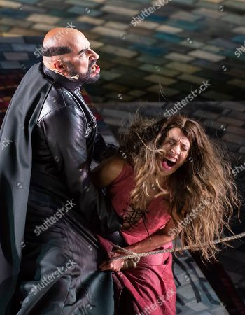 "Stock Image of German bass singer Rainer Zaun, as Bernard Gui, and German actor Eva Loeser, as A girl, play during the rehearsal of the musical ""The Name of the Rose"" (Name der Rose), based on Umberto Eco's international bestseller, by Norwegian author duo composer Gisle Kverndokk and librettist Oystein Wiik, at the DomStufen open air festival (Domstufen-Festspiele) in front of the Mariendom (Cathedral of Mary) and the St. Severi's Church in Erfurt, central Germany, . The plot tells of the Franciscan monk William of Baskerville, who on a tricky mission reaches a remote Italian abbey where mysterious deaths occur. The premiere of the musical under the direction of Axel Koehler is on Friday"