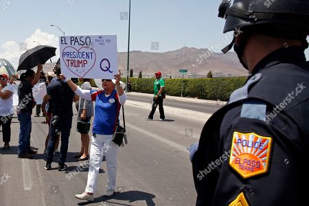 Stock Image of A supporter of President Donald Trump holds a sign during his visit to the border city after Saturday's mass shooting in El Paso, Texas, . Trump headed to El Paso, after visiting Dayton, Ohio, on Wednesday to offer a message of healing and unity, but he will be met by unusual hostility in both places by people who fault his own incendiary words as a contributing cause to the mass shootings