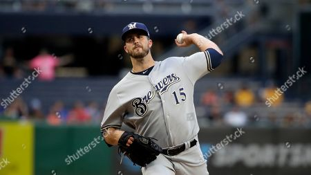 Milwaukee Brewers starting pitcher Drew Pomeranz delivers during the first inning of a baseball game against the Pittsburgh Pirates in Pittsburgh