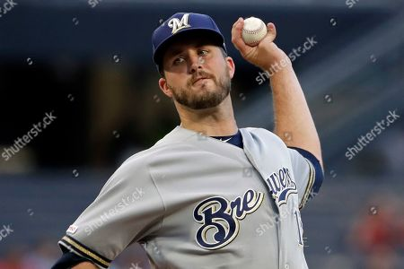 Milwaukee Brewers starting pitcher Drew Pomeranz delivers during the first inning of the team's baseball game against the Pittsburgh Pirates in Pittsburgh