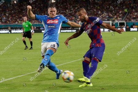 Piotr Zielinski, Rafinha. Napoli's Piotr Zielinski (20) defends against a shot by Barcelona's Rafinha during the second half of a soccer match, in Miami Gardens, Fla. Barcelona won 2-1