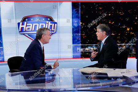 "Sean Hannity, Bill de Blasio. Fox News host Sean Hannity, right, interviews Democratic presidential candidate and New York Mayor Bill de Blasio during a taping of his show, ""Hannity,"", in New York"
