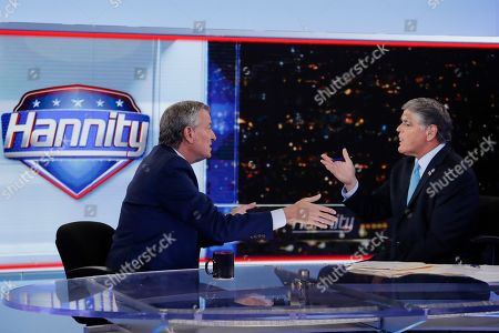 "Bill de Blasio, Sean Hannity. Fox News host Sean Hannity, right, interviews Democratic presidential candidate and New York Mayor Bill de Blasio during a taping of his show, ""Hannity,"", in New York"