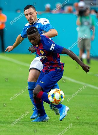 Moussa Wague (R) of FC Barcelona in action against Mario Rui (L) of SSC Napoli during the friendly soccer match between SSC Napoli and FC Barcelona at the Hard Rock Stadium in Miami, Florida, USA, 07 August 2019.