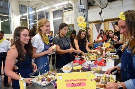 Christina Tosi, second left, shows guests how to create their ultimate dessert board, using new products from NESTLÉ TOLL HOUSE, Edible Cookie Dough and Unicorn Morsels, in New York