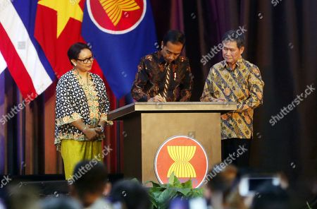 Indonesian President Joko Widodo (C) accompanied by Indonesian Foreign Minister Retno Marsudi (L) and Asean Secretary General Dato Lim Jock Hoi (R) signs a placard during the inauguration of the new ASEAN Secretariat building in Jakarta, Indonesia, 08 August 2019. The inauguration ceremony was officiated by President Joko Widodo. On the day also marked the 52nd anniversary of ASEAN's founding.