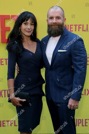 """Michael Tiddes, right, and his wife attend the LA Premiere of """"Sextuplets"""" at the Arclight Hollywood, in Los Angeles"""