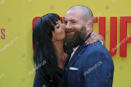 """Stock Photo of Michael Tiddes, right, smiles as his wife gives him a kiss as they arrive at the LA Premiere of """"Sextuplets"""" at the Arclight Hollywood, in Los Angeles"""