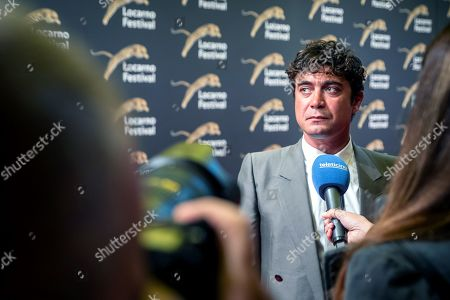 Riccardo Scamarcio, star of 'Magari', speaks to the media on the red carpet during the opening night of the Locarno Film Festival 2019 at Piazza Grande in Locarno, Switzerland, 07 August 2019 (issued 08 August 2019). The festival will run until 17 August 2019 and will feature films from more than 60 countries.