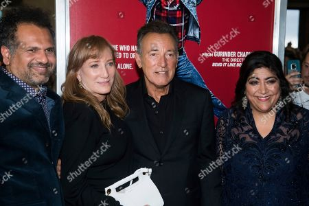 """Patti Scialfa, Bruce Springsteen, Gurinder Chadha, Sarfraz Manzoor. Sarfraz Manzoor, left, Patti Scialfa, Bruce Springsteen and Gurinder Chadha attend the premiere of """"Blinded by the Light"""" at the Paramount Theater, in Asbury Park, NJ"""