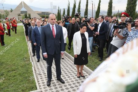 Georgian Prime Minister Mamuka Bakhtadze (L) and Georgian President Salome Zurabishvili (R) attend a wreath laying ceremony at a cemetery in Tbilisi, Georgia, 08 August 2019. An official ceremony was held here on the occasion of the eleventh anniversary of the Russian-South Ossetian-Georgian conflict, or Russo-Georgian War of August 2008.