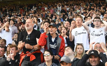 Actor Charlie Cooper, best known for his role as Lee Mucklow in This Country, reacts among fans in the Hammersmith End