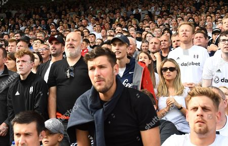 Actor Charlie Cooper, best known for his role as Lee Mucklow in This Country, looks on among fans in the Hammersmith End